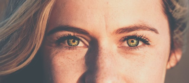 warm green eyes and freckled nose