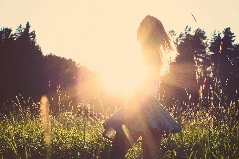 girl walking in sun