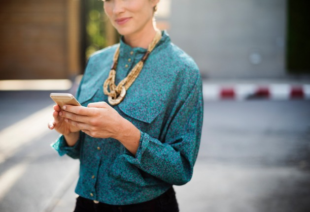 Woman viewing text message