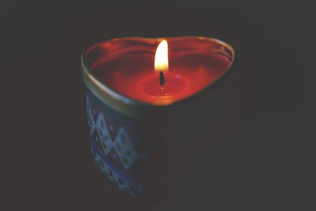 candlelight from heart-shaped candle