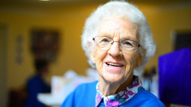 chipper, upbeat elderly woman