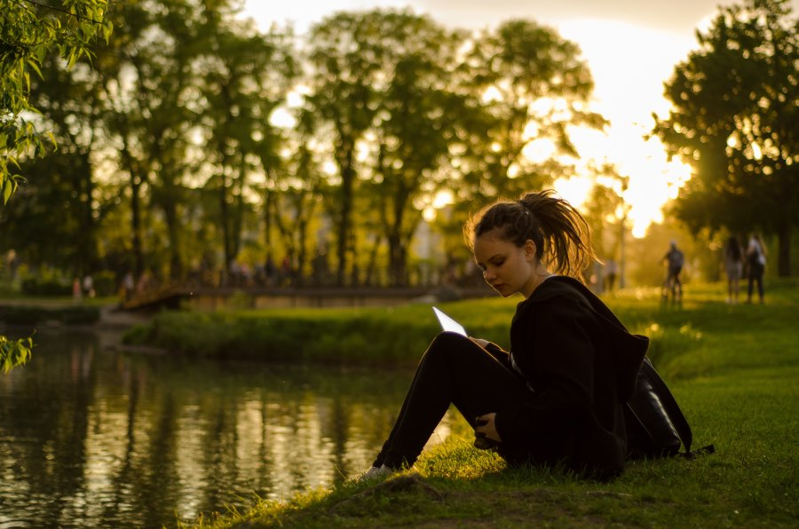 woman studying in people-watching spot