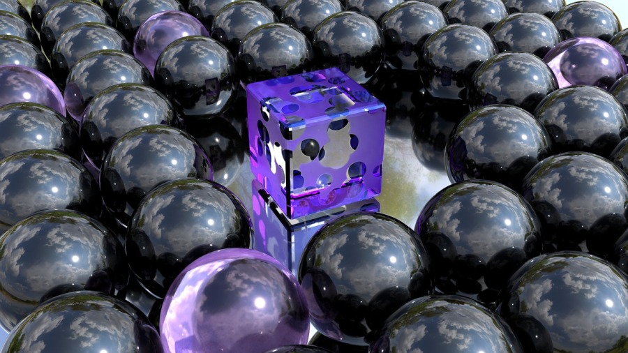 purple blue reflection cube with black spots surrounded by uniform spheres