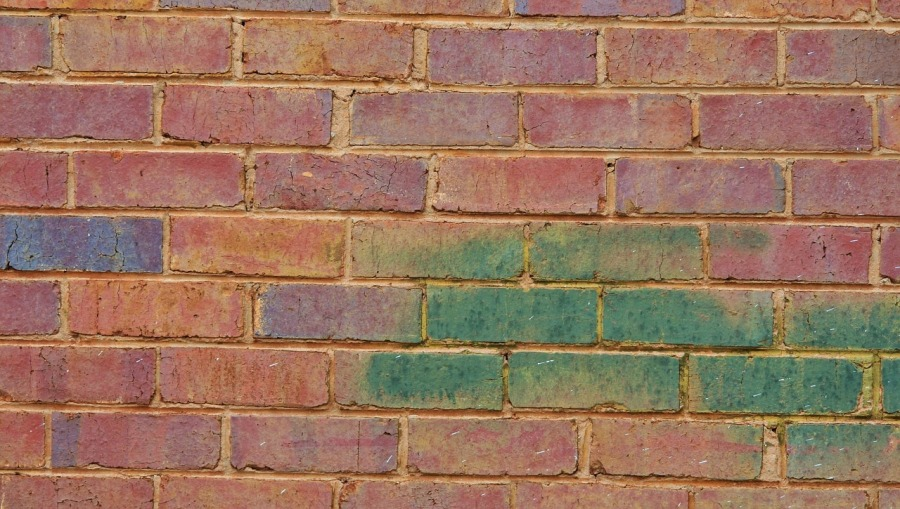 picture of whole with different parts (brick wall with bricks of different colors) - composition fallacy - logic